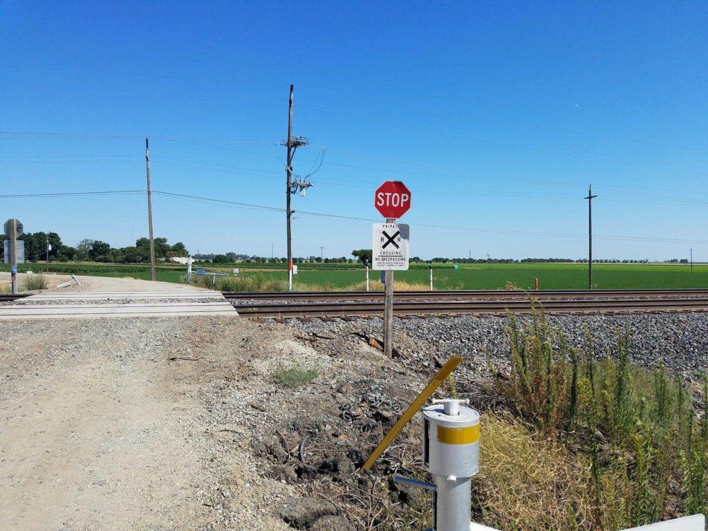 stop sign at railroad