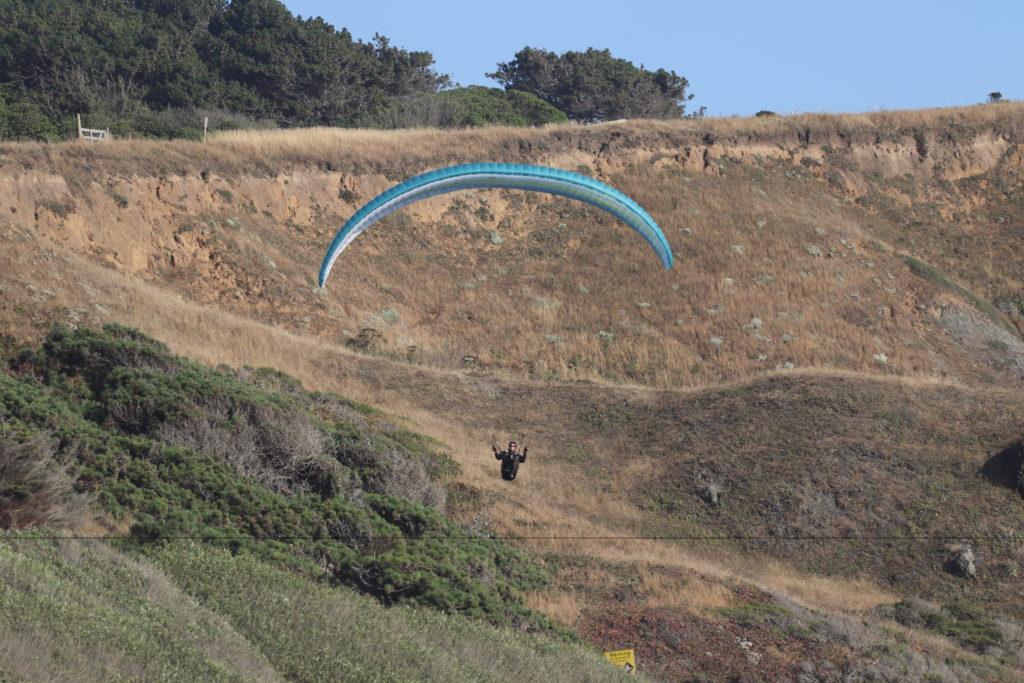 Paragliding activity at Goat Rock Beach.